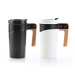 HDC6004 CERAMIC MUG -A must have ceramic tumbler. The matt finish body and natural wooden handle are combined by the black coated stainless steel band. Push on, slide lock lid included. Volume capacity is 475ml. Presented in a gift box.